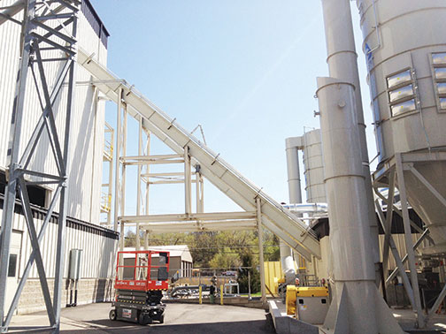 The redesigned L Path En-Masse Conveyor System effectively handled feedstock from truck unload to the storage silos.
